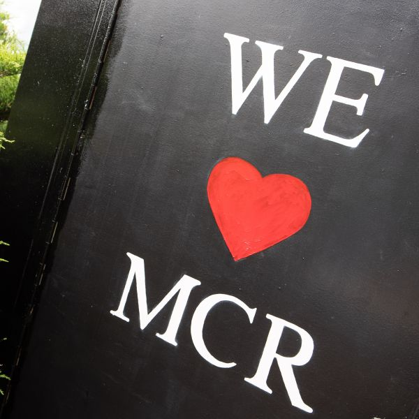 "Photograph of a sign that reads ""We (heart) MCR"""